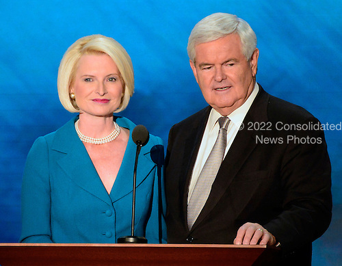 Former Speaker of the United States House of Representatives Newt Gingrich (Republican of Georgia) and his wife, Callista, make remarks at the 2012 Republican National Convention in Tampa Bay, Florida on Thursday, August 30, 2012.  .Credit: Ron Sachs / CNP.(RESTRICTION: NO New York or New Jersey Newspapers or newspapers within a 75 mile radius of New York City)