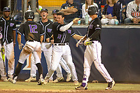 University of Washington Huskies celebrate as Kaiser Weiss (12) scores to tie up the game in the bottom of the ninth inning against the Cal State Fullerton Titans at Goodwin Field on June 10, 2018 in Fullerton, California. The Huskies defeated the Titans 6-5. (Donn Parris/Four Seam Images)