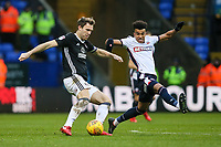 Bolton Wanderers' Derik Osede vies for possession with  Fulham's Kevin McDonald<br /> <br /> Photographer Andrew Kearns/CameraSport<br /> <br /> The EFL Sky Bet Championship - Bolton Wanderers v Fulham - Saturday 10th February 2018 - Macron Stadium - Bolton<br /> <br /> World Copyright &copy; 2018 CameraSport. All rights reserved. 43 Linden Ave. Countesthorpe. Leicester. England. LE8 5PG - Tel: +44 (0) 116 277 4147 - admin@camerasport.com - www.camerasport.com