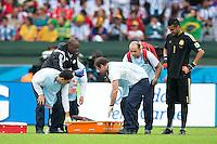Michael Babatunde of Nigeria is taken off injured