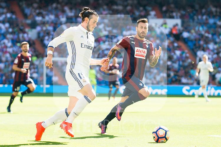Real Madrid's player Gareth Bale and Eibar FC's player Antonio Luna during a match of La Liga Santander at Santiago Bernabeu Stadium in Madrid. October 02, Spain. 2016. (ALTERPHOTOS/BorjaB.Hojas)