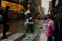 The Naked Cowboy walks at Times Square as he wears a green cape as part of the 252nd annual St. Patrick's Day Parade in New York City. Photo by Eduardo Munoz Alvarez / VIEWpress.