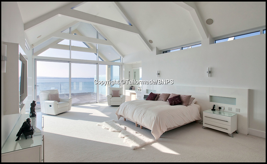 BNPS.co.uk (01202) 558833<br /> Pic: Tailormade/BNPS<br /> <br /> Let there be light - the house is flooded with sea views.<br /> <br /> Stunning super home for sale - If you've got £9 million to spare...<br /> <br /> This state of the art mega-home is for sale on the exclusive millionaires playground of Sandbanks in Poole, Dorset.<br /> <br /> The biggest, most expensive, and luxurious home ever to come on the market on the tiny peninsula, it is now selling for a cool £8.75m.<br /> <br /> Called The Moorings, the harbour front mansion has stunning sea views, and is on one of the most enviable plots on Millionaire's Row.<br /> <br /> Its owners, entrepreneur Chris Thomas and wife Sue, spent a staggering £5.5m building the palatial home that has been compared to a five star hotel.<br /> <br /> Spread over 13,000 sq ft - the equivalent size of seven detached houses - the state-of-the art property comes with five en suite bedrooms, three reception rooms, an office, cinema room, indoor swimming pool, sauna, gym, gate house and boat house.