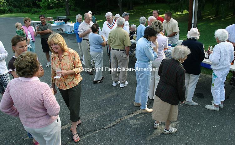 WASHINGTON, CT -17 June 2004- 061705BZ01- People gathered behind the firehouse in Washington for the Village Improvement Society's annual picnic Friday night.<br /> Jamison C. Bazinet photo