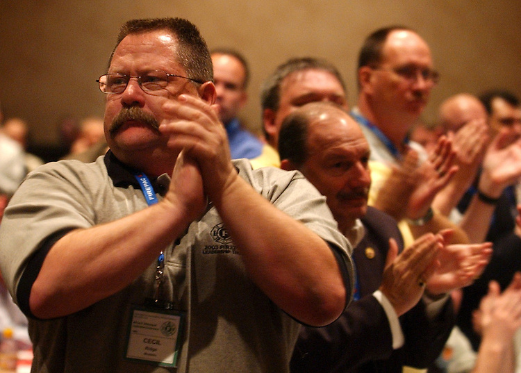 Fire Fighter Cecil Ridge of Modesto Calif., applauds a speach by Sen. John Kerry, D-Mass., at the International Association of Fire Fighters Legislative Conference, Monday.