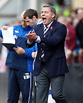 Ally McCoist getting stuck into the atmosphere at Tynecastle as he applauds his table topping team