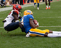 In overtime Pitt defensive back Therran Coleman (4) intercepts a Syracuse pass intended for Syracuse wide receiver Nykiem Johnson to win the game for Pitt.The Pitt Panthers defeated the Syracuse Orange 44-37 in overtime at Heinz Field in Pittsburgh, Pennsylvania on October 6, 2018.