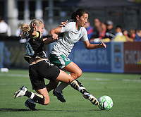FC Gold Pride's Leslie Osborne slide tackles Stephanie Logterman..St. Louis Athletica over FC Gold Pride 1-0 at Buck Shaw Stadium, in Santa Clara, California, Sunday, July 5, 2009.