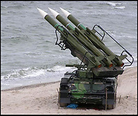BNPS.co.uk (01202 558833)<br /> Pic: Brightwells/BNPS<br /> <br /> In action...<br /> <br /> From Russia with love...SAM 6 missile anyone?<br /> <br /> At a time when Anglo-Russian relations are at an all-time low, an enormous Soviet missile has been launched and is heading for Britain.<br /> <br /> But before Brits start heading for the nuclear fall out shelter, the 19ft long surface-to-air rocket is inert and is now a highly unusual antique <br /> <br /> The Cold War-era 2K12 Kub (SAM 6 in the west) missile that had a top speed of 1,345mph and a range of 45,000ft is to be sold by auctioneers Brightwells of Bicester, Oxon.<br /> <br /> The rocket is currently in transit from Russia to the UK at the moment...by ship.