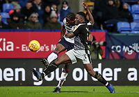 Bolton Wanderers' Clayton Donaldson  shoots at goal under pressure from Reading's Andy Yiadom  <br /> <br /> Photographer Andrew Kearns/CameraSport<br /> <br /> The EFL Sky Bet Championship - Bolton Wanderers v Reading - Tuesday 29th January 2019 - University of Bolton Stadium - Bolton<br /> <br /> World Copyright © 2019 CameraSport. All rights reserved. 43 Linden Ave. Countesthorpe. Leicester. England. LE8 5PG - Tel: +44 (0) 116 277 4147 - admin@camerasport.com - www.camerasport.com