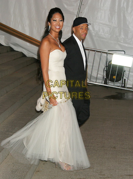 "KIMORA LEE SIMMONS & RUSSEL SIMMONS.""Chanel"" Costume Institute Gala at The Metropolitan Museum of Art - Arrivals.The Metropolitan Museum of Art, New York City.New York City.May 2nd, 2005.full length strapless white dress sheer chiffon drop waist baseball cap.www.capitalpictures.com.sales@capitalpictures.com.©Capital Pictures"