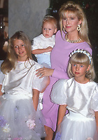 KathyHilton holding Baron Hilton II<br /> Nicki Hilton and Paris Hilton 1990<br /> Photo By John Barrett/PHOTOlink