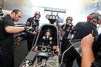 Apr 10, 2015; Las Vegas, NV, USA; Crew members with NHRA top fuel driver Dave Connolly warming up in the pits during qualifying for the Summitracing.com Nationals at The Strip at Las Vegas Motor Speedway. Mandatory Credit: Mark J. Rebilas-
