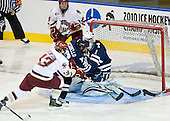 Joe Whitney (BC - 15) (not visible to the far right) reaches the loose puck to make it 3-1 2:23 into the second period. - The Boston College Eagles defeated the Yale University Bulldogs 9-7 in the Northeast Regional final on Sunday, March 28, 2010, at the DCU Center in Worcester, Massachusetts.