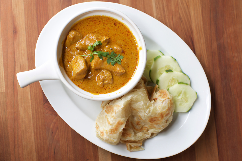 BROOKLYN, NY - July 8, 2015: Mum's Malaysian Chicken Curry, with Roti Canai at Parlay, a cafe on Eighth Avenue in Sunset Park.<br /> <br /> Credit: Clay Williams.<br /> <br /> &copy; Clay Williams / http://claywilliamsphoto.com