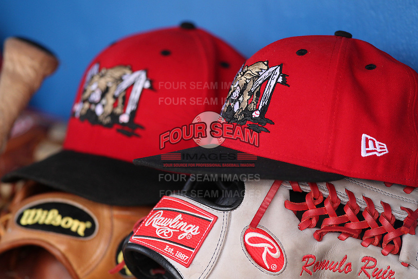 Batavia Muckdogs hat and gloves on the bench during a game against the State College Spikes at Dwyer Stadium on July 7, 2011 in Batavia, New York.  Batavia defeated State College 16-3.  (Mike Janes/Four Seam Images)