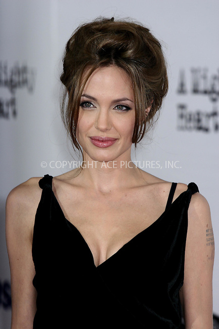 WWW.ACEPIXS.COM . . . . .  ....June 13, 2007. New York City.....Actress Angelina Jolie attends the New York premiere of 'A Mighty Heart' held at Ziegfeld Theatre.....In the movie Angelina Jolie plays Mariane Pearl, wife of slain Wall Street Journal reporter Daniel Pearl.......Please byline: JOHN WARD - ACEPIXS.COM.... *** ***..Ace Pictures, Inc:  ..Philip Vaughan  (646) 769 0430..e-mail: info@acepixs.com..web: http://www.acepixs.com