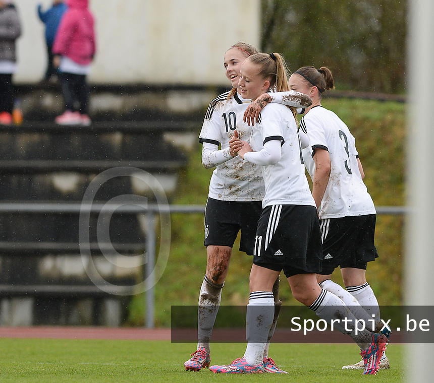 20150404 - FORST , GERMANY  : Germany  pictured celebrating a goal with Laura Freigang (10) and German Lea Schuller (11) during the soccer match between Women Under 19 teams of Germany and Scotland , on the first matchday in group 5 of the UEFA Elite Round Women Under 19 at WaldseeStadion , Forst , Germany . Saturday 4th April 2015 . PHOTO DAVID CATRY