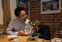 Peter Zhang, Managing Director, SinoFortone Group behind the bar at the The Plough at Cadsden, Buckinghamshire. The group bought the pub after it was visited by Chinese Premiere Ji Jinping last year, and aim to develop  a chain of English-style pubs China.<br /> <br /> Photo by Richard Jones / Sinopix for the Asia Times