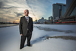 Atlantic City Mayor Don Guardian stands on a snow covered winter Atlantic City, New Jersey beach.
