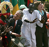 United States President George W. Bush and first lady Laura Bush  dance with the Kankouran West African Dance Company during a Malaria Awareness Day event in the Rose Garden of the White House in Washington, D.C. on April 25, 2007.  <br /> Credit: Dennis Brack / Pool via CNP