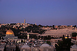 Israel, Jerusalem, a view of the Old City and the Dome of the Rock at night, Mount of Olives is in the background