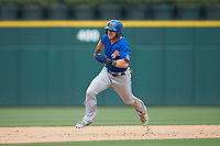 Mike Brosseau (9) of the Durham Bulls hustles towards third base against the Charlotte Knights at BB&T BallPark on May 27, 2019 in Charlotte, North Carolina. The Bulls defeated the Knights 10-0. (Brian Westerholt/Four Seam Images)