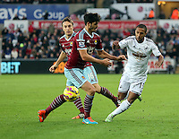 Pictured: Wayne Routledge of Swansea (R) finds it hard to get past two West Ham players Saturday 10 January 2015<br />