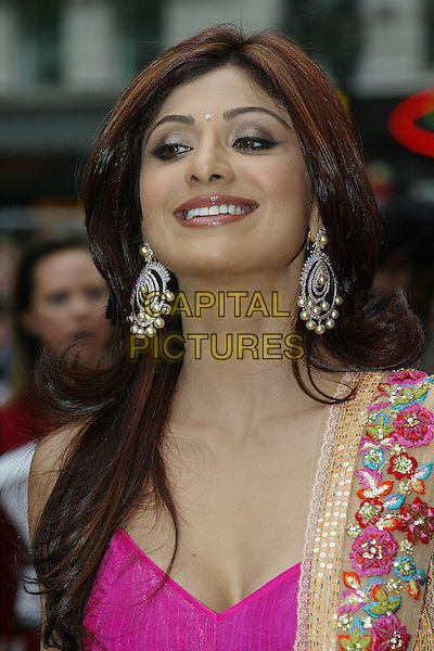 "SHILPA SHETTY.""Life In A ... METRO"" world premiere at the Empire Leicester Square, London, England..May 8th, 2007.headshot portrait earrings pearl diamond bindi  pink.CAP/DAR.©Darwin/Capital Pictures"