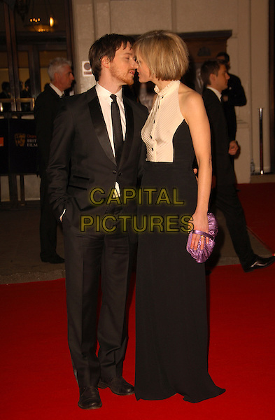 JAMES McAVOY & ANNE-MARIE DUFF.Arrivals at The Orange British Academy Film & Television Awards 2008 at the Royal Opera House, Covent Garden, London, England. .February 10th, 2008 .BAFTA Arts full length black suit white dress couple hand in pocket clutch bag purse profile kiss kissing .CAP/CAS.©Bob Cass/Capital Pictures.