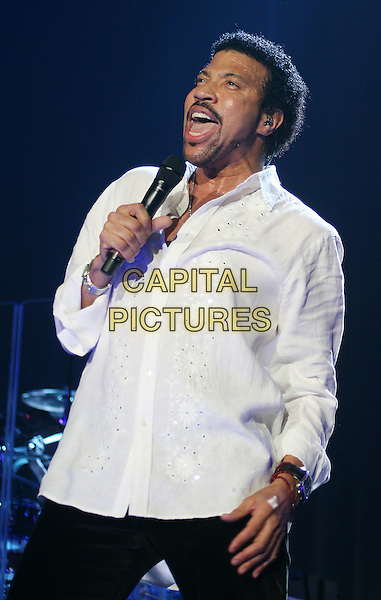 LIONEL RICHIE.Live in concert at the Wembley Arena, London, England..March 23rd, 2007 .stage concert gig performance music half length white shirt goatee facial hair singing.CAP/MAR.© Martin Harris/Capital Pictures.