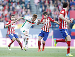 Atletico de Madrid's Angel Correa (l), Oliver Torres (c-r) and Diego Godin (r) and Granada Club de Futbol's Adalberto Penaranda during La Liga match. April 17,2016. (ALTERPHOTOS/Acero)
