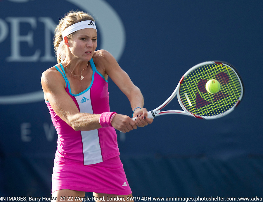 MARIA KIRILENKO (RUS) (25) against EKATERINA MAKAROVA (RUS) in the 1st round of the women's singles. Maria Kirilenko beat Ekaterina Makarova 4-6 6-1 7-6..Tennis - Grand Slam - US Open - Flushing Meadows - New York - Day 01 - Mon August 29th  2011..© AMN Images, Barry House, 20-22 Worple Road, London, SW19 4DH, UK..+44 208 947 0100.www.amnimages.photoshelter.com.www.advantagemedianetwork.com.
