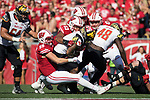 Wisconsin Badgers linebackers Tyler Johnson (59), T.J. Edwards (53) and Ryan Connelly (43) make a tackle during an NCAA Big Ten Conference football game against the Maryland Terrapins Saturday, October 21, 2017, in Madison, Wis. The Badgers won 38-13. (Photo by David Stluka)