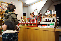 Customers buying shichimi at Yagenbori shichimi, Asakusa, Tokyo, Japan, February 19, 2011.Yagenbori, founded in 1625 was the first to produce the now popular Japanese condiment.