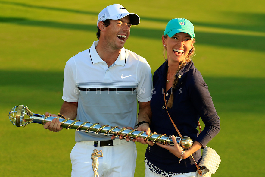 Rory McIlroy (IRE) and girlfriend Erica Stoll pose with the trophy during the final round of the DP World Golf Championship played at the Earth Course, Jumeira Golf Estates, Dubai 19-22 November 2015. (Picture Credit / Phil Inglis )