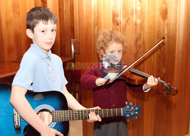 Patrick Maguire and Sarah Fox at the Drogheda Branch of Comhaltas Music Classes in The Holy Family Community Centre...(Photo credit should read Jenny Matthews/www.newsfile.ie)....This Picture has been sent you under the conditions enclosed by:.Newsfile Ltd..The Studio,.Millmount Abbey,.Drogheda,.Co Meath..Ireland..Tel: +353(0)41-9871240.Fax: +353(0)41-9871260.GSM: +353(0)86-2500958.email: pictures@newsfile.ie.www.newsfile.ie.