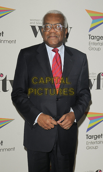 SIR TREVOR McDONALD.The Target Women in Film & TV Awards, London Hilton hotel, park Lane, London, England..December 5th, 2008.half length black suit jacket red tie glasses macdonald.CAP/CAN.©Can Nguyen/Capital Pictures.