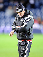Manager Francesco Guidolin of Swansea City  checks his watch before the Barclays Premier League match between West Bromwich Albion and Swansea City at The Hawthorns on the 2nd of February 2016