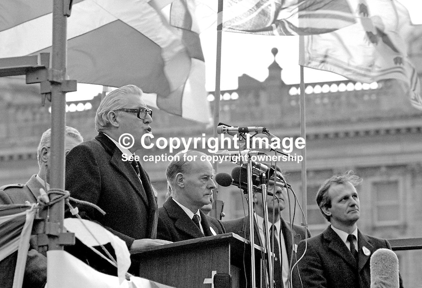 Anti Anglo-Irish Agreement Rally, City Hall, Belfast, Saturday, 23rd November 1985 - Democratic Unionist Party leader, Rev Ian Paisley, addresses the rally. Also in photo are James Molyneaux, leader, Ulster Unionist Party, and Rev William McCrea, DUP, MP (extreme right). 19851112z.<br /> <br /> Copyright Image from Victor Patterson, 54 Dorchester Park, <br /> Belfast, UK, BT9 6RJ<br /> <br /> t1: +44 28 9066 1296 (from Rep of Ireland 048 9066 1296)<br /> t2: +44 28 9002 2446 (from Rep of Ireland 048 9002 2446)<br /> m: +44 7802 353836<br /> <br /> e1: victorpatterson@me.com<br /> e2: victorpatterson@gmail.com<br /> www.victorpatterson.com<br /> <br /> Please see my Terms and Conditions of Use at www.victorpatterson.com. It is IMPORTANT that you familiarise yourself with them.<br /> <br /> Images used on the Internet must be visibly watermarked i.e. &copy; Victor Patterson<br /> within the body of the image and copyright metadata must not be deleted. Images <br /> used on the Internet have a size restriction of 4kbs and will be chargeable at current<br />  NUJ rates unless agreed otherwise.<br /> <br /> This image is only available for the use of the download recipient i.e. television station, newspaper, magazine, book publisher, etc, and must not be passed on to any third <br /> party. It is also downloaded on condition that each and every usage is notified within 7 days to victorpatterson@me.com<br /> <br /> The right of Victor Patterson to be identified as the author is asserted in accordance with The Copyright Designs And Patents Act (1988).