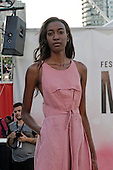 A model poses on the runway at the Eliza Faulkner fashion show held during the Fashion and Design fashion show in downtown Montreal. August 17 2016
