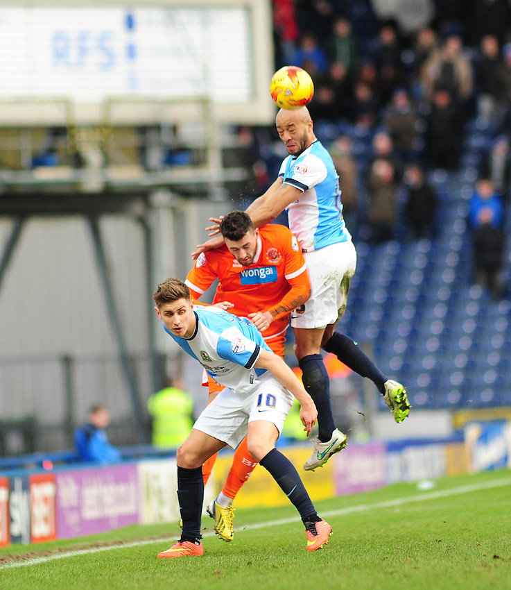 Blackburn's Tom Cairney gets in front of Blackpool's Gary Madine so that Alex Baptiste can head clear<br /> <br /> Photographer Andrew Vaughan/CameraSport<br /> <br /> Football - The Football League Sky Bet Championship - Blackburn Rovers v Blackpool - Saturday 21st February 2015 - Ewood Park - Blackburn<br /> <br /> &copy; CameraSport - 43 Linden Ave. Countesthorpe. Leicester. England. LE8 5PG - Tel: +44 (0) 116 277 4147 - admin@camerasport.com - www.camerasport.com