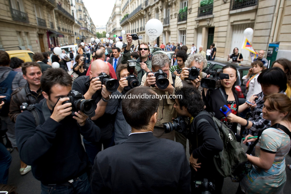 Press photographers surround Reporters Sans Frontieres Secretary General, Robert Menard (C, foreground) during a street protest called by the press watchdog organisation against China's human rights policy, close to the Chinese embassy in Paris, France, on the day of the opening ceremony of the 2008 Olympic Games in Beijing, 8 August 2008.