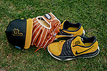5 March 2019: Pittsburgh Pirates glove, cleats, and cap lie outside the batting cage at Pirate City in Bradenton, Florida. Mandatory Credit: Ed Wolfstein Photo *** RAW (NEF) Image File Available ***