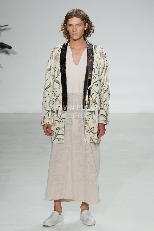 Model walks runway in a floral upholstery neneko and Japanese cotton kaftan, from the Palmiers du Mal Spring Summer 2017 collection by Brandon Capps and Shane Fonner, at Skylight Clarkson Square on July 14 2016, during New York Fashion Week Men's Spring Summer 2017.