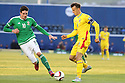 Romania's Vlad Chiriches is confronted by Northern Ireland's Kyle Lafferty during the UEFA EURO 2016 qualifying Group F soccer match between Northern Ireland and Romania at Windsor Park in Belfast, Northern Ireland, 13 June 2015.  EPA/PauL McErlane