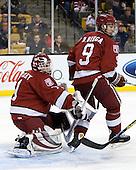 John Riley (Harvard - 1), Danny Biega (Harvard - 9) - The Boston College Eagles defeated the Harvard University Crimson 6-0 on Monday, February 1, 2010, in the first round of the 2010 Beanpot at the TD Garden in Boston, Massachusetts.