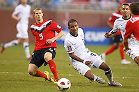 7 June 2011: Canada defender Andre Hainault (5) and USA Men's National Team forward Juan Agudelo (9) go for the ball during the CONCACAF soccer match between USA and Canada at Ford Field Detroit, Michigan. USA won 2-0.
