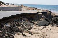 Sections of the parking lot have been closed off because of severe damage from storms earlier this year at Herring Cove Beach in the Cape Cod National Seashore outside of Provincetown, Mass., USA, seen here on Fri., July 1, 2016. Other beaches in the area have also experienced coastal retreat.