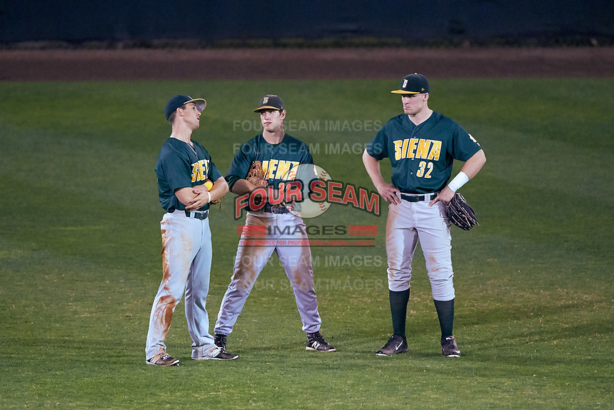 Siena Saints outfielders Alex Tuccio (20), Dan Swain (22), and Fred Smart (32) during a game against the Stetson Hatters on February 23, 2016 at Melching Field at Conrad Park in DeLand, Florida.  Stetson defeated Siena 5-3.  (Mike Janes/Four Seam Images)